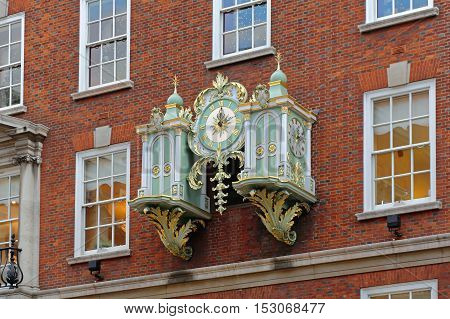 LONDON UNITED KINGDOM - NOVEMBER 21: Fortnum and Mason Clock in London on NOVEMBER 21 2013. Famous Decorative Clock at Fortnum and Mason at Piccadilly Street in London United Kingdom.