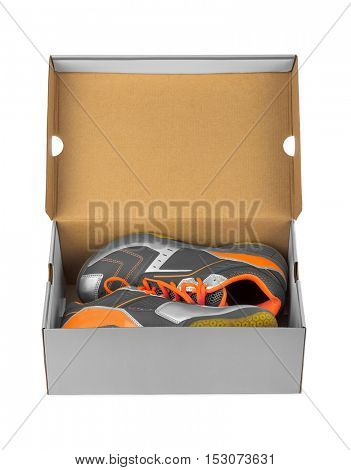 Sport sneakers in box isolated on white background
