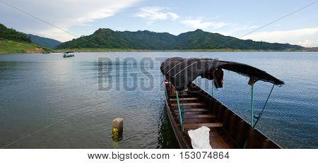 A Fishing Boat Tied At The Shore At Khun Dan Dam, Nakohn Nayok Thailand
