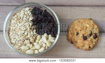 Ingredients for baking healthy cookies in glass bowl and ready cookies