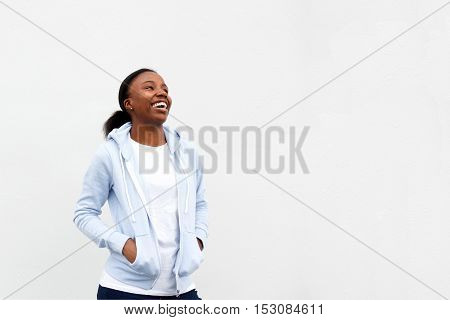 African Woman Standing With Hands In Pockets
