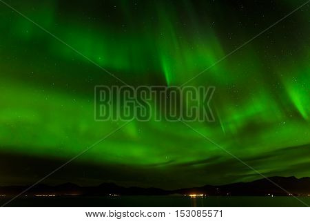 A beautiful green Aurora borealis or northern lights at Tromso Norway