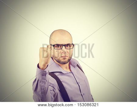 Angry Businessman Threaten With A Fist