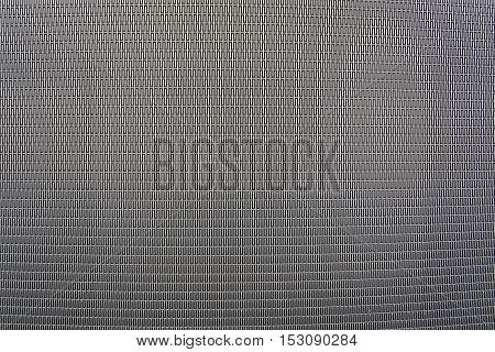 Background sheet of metal covered with abstract lines of holes