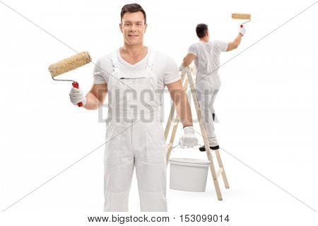 Painter holding a paint roller and a color bucket with another painter painting climbed up a ladder isolated on white background