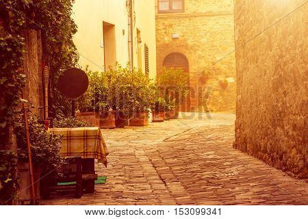 Empty street of small Tuscany town San Quirico d'Orcia with sun shine, romantic travel vintage hipster european italy background