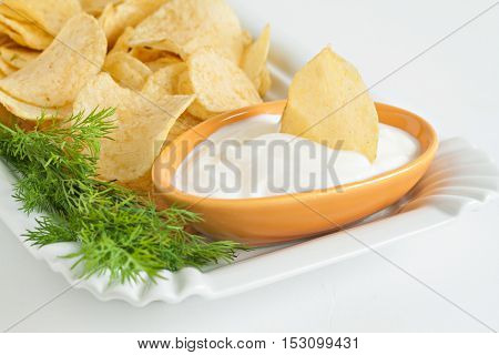 Chips With Sour Cream And Dill Sauce Isolated
