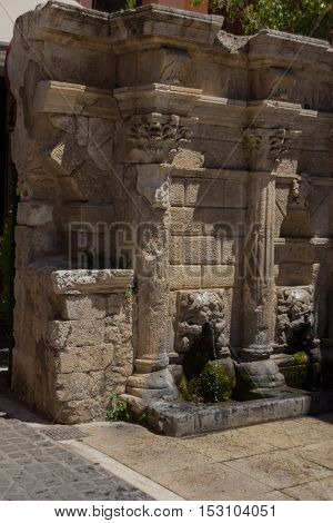 The Rimondi Fountain in Rethymno Crete Greece. The Rimondi fountain was built in 1626 by the city''s Rector A. Rimondi. It covered part of the city''s water needs and it is located in the Platanou square which was then the centre of the Venetian city.