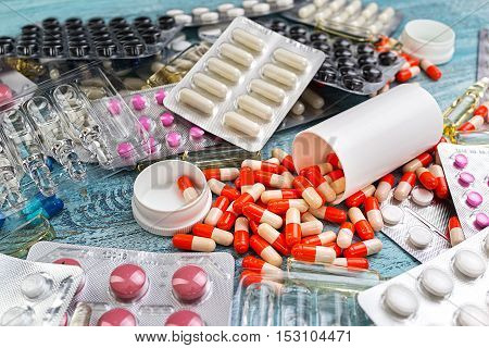 Drug ampules prescription for treatment medication. Heap of red orange white round capsule in stick pills with medicine antibiotic in packages. Pharmacy theme, Pharmaceutical medicament for health