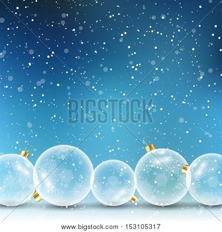 Glass Christmas baubles on a snowy background