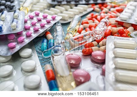 Heap of red orange white round capsule in stick pills with medicine antibiotic in packages. Pharmacy theme, Pharmaceutical medicament for health. Drug ampules prescription for treatment medication