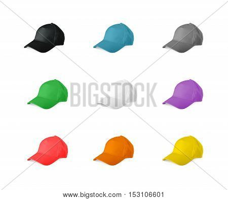 Set of colored baseball caps on a white background