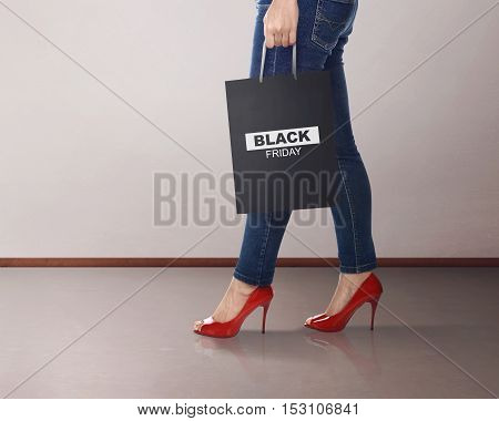 Casual Woman With Black Friday Paper Bag