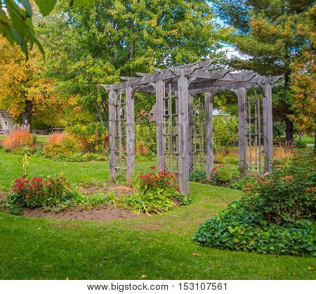Wooden arch in floral garden.  Lovely wedding setting complete with an arboretum in a green floral garden.