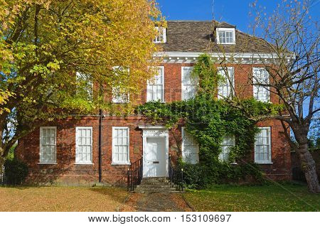 ST NEOTS, CAMBRIDGESHIRE, ENGLAND - OCTOBER 22, 2016: Brook House an attactive red brick georgian House dating from about 1700