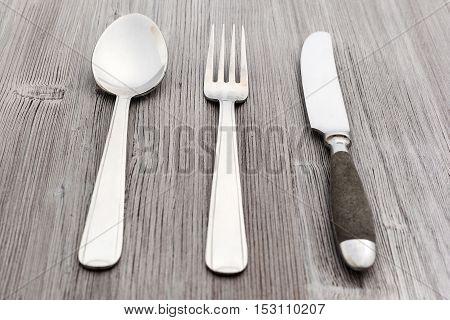 Flatware Set From Knife, Fork, Spoon On Wood Board