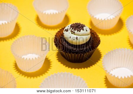 Small Birthday cupcake against a yellow background