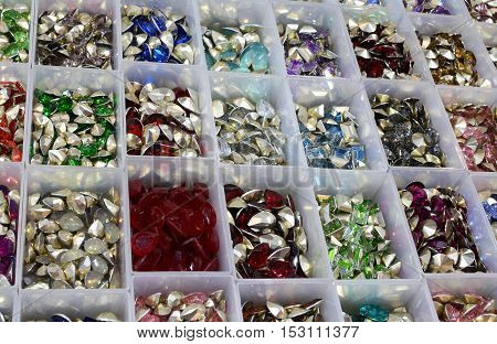 Boxes With Tiaras And Stones For Decoration And Necklaces