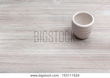 White Cup For Sake On Gray Brown Wooden Board