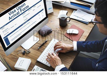 Businessman filling out visa application form