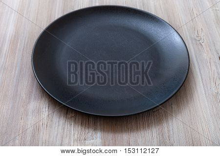 Black Plate On Gray Brown Table