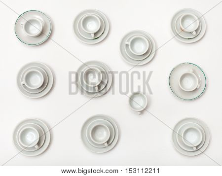 Top View Of Many White Cups And Saucers On White