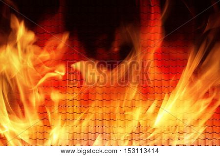 Red tiles roof on fire with flames.