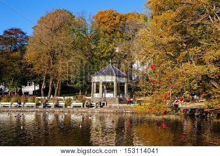 STAVANGER, NORWAY - OCTOBER 14, 2016: People relaxing in City Park on a beautiful autumn day in Stavanger. Stavanger is one of most famous cruise travel destinations in Europe.