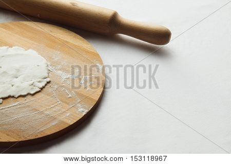 dough sieve flour and baker's rolling pin