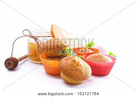 Sweet homemade pumpkin muffins on white background