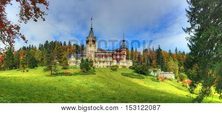 Beautiful panorama with famous and medieval Peles castle in autumn season, Sinaia - Romania