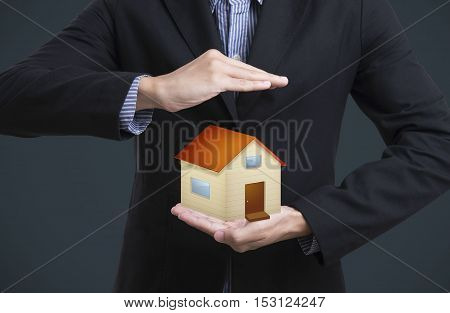 business salesman hand holding protection home concept home insurance.