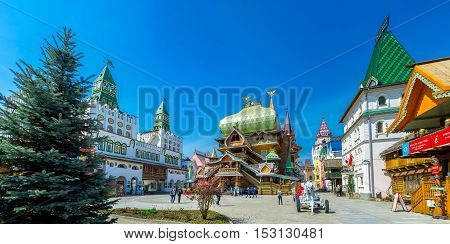 MOSCOW RUSSIA - MAY 10 2015: Izmailovsky Kremlin boasts wooden Tsar's Palace with great dome and scenic fortress gate decorated with bright green towers on May 10 in Moscow.