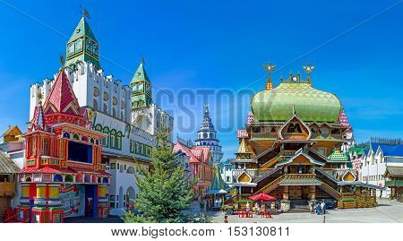 MOSCOW RUSSIA - MAY 10 2015: The wooden Tsar's Palace in Izmailovsky Kremlin surrounded by colorful mansions decorative fortress gate colorful cones of various towers on May 10 in Moscow.