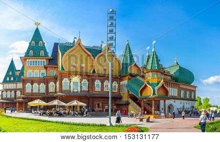 MOSCOW RUSSIA - MAY 10 2015: Panorama of the Grand Palace of Tsar Alexei Mikhailovich in Kolomenskoye Manor with complex roof carved pillars of porch and patterned window frames on May 10 in Moscow.