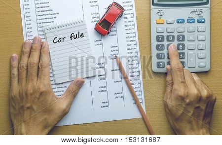 Man Planning Car fule expenses , Finance concept