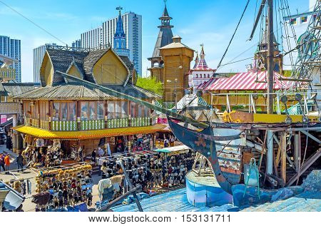 MOSCOW RUSSIA - MAY 10 2015: The wooden ship on the timbered sea is one of the most unusual and amazing decorations of Izmailovsky Market on May 10 in Moscow.