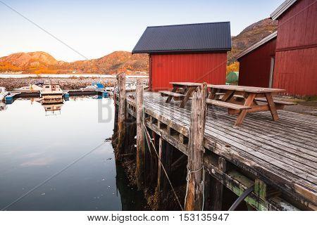Norwegian Red Wooden Barns On Coast