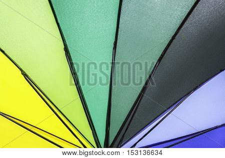 Multi rainbow colored summer umbrella pattern background