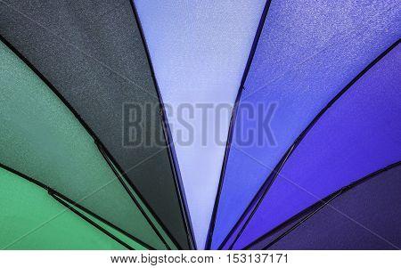 Closeup rainbow colored summer umbrella pattern background