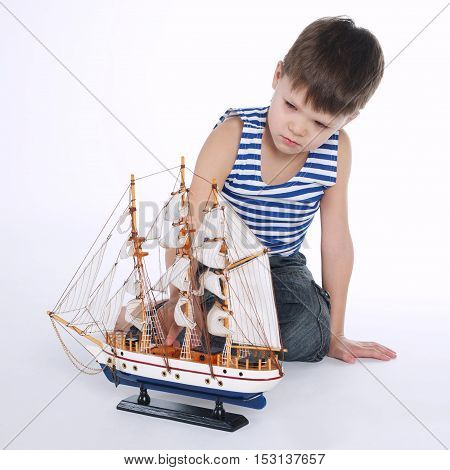 photo of little boy with ship on white
