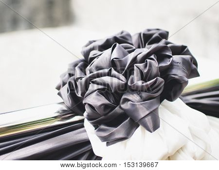 Selective Focus and Close up Black Bow for Funeral, Retro Tone (Funeral, mourning, black)
