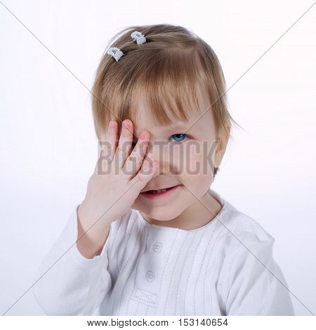 photo of cute girl hiding face with hand