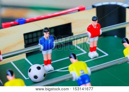 football table soccer Table football game Soccer table with red and yellow players.table football soccer game (kicker)
