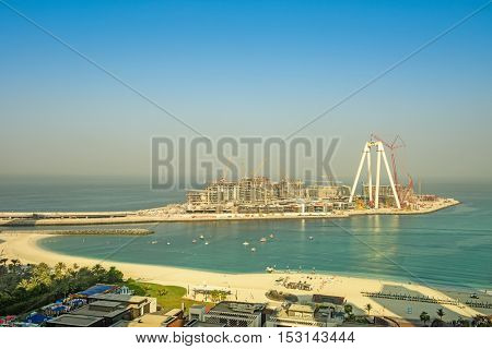 Dubai, UAE - OCTOBER 06, 2016: Bluewaters island construction in Dubai, UAE on October 06, 2016. Located off Jumeirah Beach Residence it will be the world's largest Ferris wheel, The Dubai Eye.