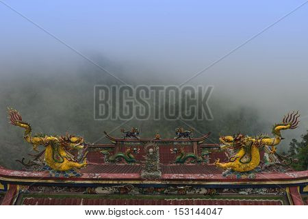 dragon temple in valley hill mountain among fog in clod weather climate / dragon temple in mountain