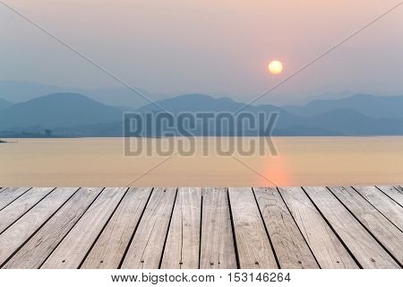 Old wood textured with landscape at sunset background