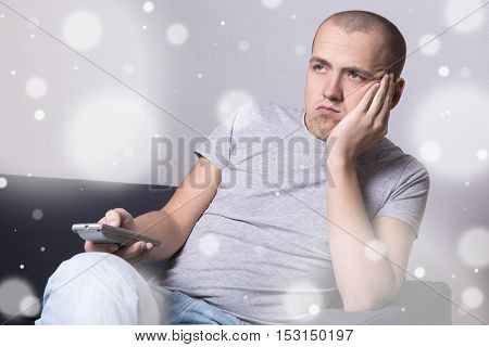 Winter Boredom - Bored Man Sitting On Sofa And Watching Movie Or Tv