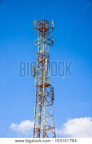 Cellular antenna against blue sky and the moon. illustration transceiver