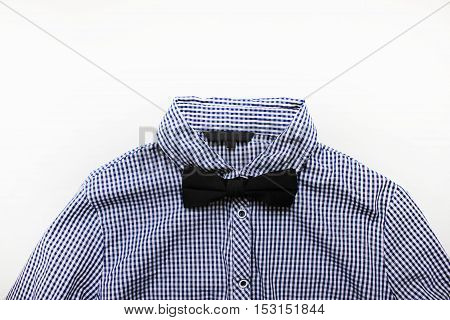 Plaid white and blue shirt with black bow tie close up isolated. Official fashion clothes detail stylish man guy look with empty background for text